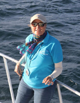 Kim Beddall of Whale Samana on Pura Mia 55 Foot Custom Whale Watching Vessel at the Main Dock of Port of Samana Town, Dominican Republic.